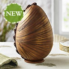 Venezuelan Milk Chocolate Easter Egg | A superb handcrafted egg, made from the finest Venezuelan milk chocolate and decorated with a hand-piped spun chocolate design and a golden shimmer.