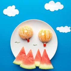 watermelon mountains with orange hot air balloons is the cutest way to prep a breakfast fruit plate! Play with good food, fun food for kids Cute Snacks, Cute Food, Good Food, Funny Food, Toddler Meals, Kids Meals, Food Art For Kids, Fruit Art Kids, Creative Food Art