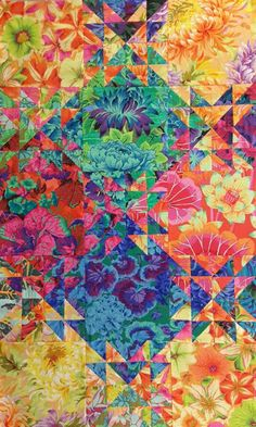 Have just started my third shimmering quilt (Jenny Bowker's pattern), here is from the middle part. All KFC fabrics, the colors make me happy.