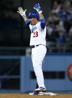 Adrian Gonzalez #23 of the Los Angeles Dodgers celebrates at second base after his double rought in the tying run in the ninth inning against the Tampa Bay Rays at Dodger Stadium on August 9, 2013 in Los Angeles, California. The Dodgers won 7-6. (Photo by Stephen Dunn/Getty Images)
