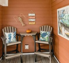 Fall Beach Cottage Porch Decor Idea... http://www.completely-coastal.com/2016/09/fall-beach-decor-orange-cottage.html A cozy sheltered sitting area on a porch with coastal and nautical decor....