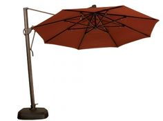DIY Tip: Never fill a patio umbrella base with water, as water evaporates. On a windy day, your umbrella may tip over and get damaged – or damage your other outdoor furnishings. - Rich's for the Home Colorful Umbrellas, Patio Umbrellas, Offset Umbrella, Cantilever Umbrella, Mesh Screen, Hacks Diy, Deck, Outdoor Decor, Base