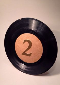 Table number records 45 rpm vinyl record table numbers vinyl record table number wedding table number gold vinyl from MissWhitsDesigns on. Record Table, Sock Hop Party, Wedding Table Numbers, Gold Paint, Vinyl Records, Repurpose, Reuse, Unique Jewelry, Handmade Gifts