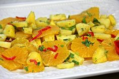 A delicious summer time salad made with oranges and pineapple. click for the recipe with cooking demo.