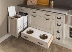Love/need the drawer with the trash cans!