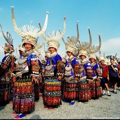 Dali, Yunnan, China * Yunnan Province lies deep in China's southwest, home to almost half of China's ethnic groups.  The ancient capital of Dali, between Lake Erhai and the towering Cang Mountains, is the land of the Bai, whose traditional costumes feature colorful embroidery and highly decorated bonnets.