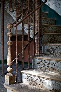 Like these stairs, though they look like the railing might crumble under the slightest pressure.  Liket the repeating motif on the fronts of the steps.