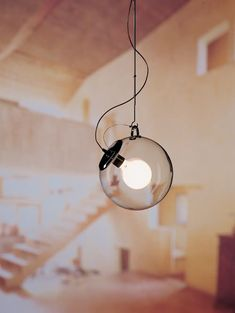 Fixture design Miconos collection designed by Ernesto Gismondi for Artemide features glass globes over exposed bulbs, very simple and elegant