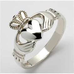 The Irish Clauddagh Ring.  The heart symbolizes Love, the hands Friendship, and the crown Loyalty.