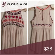 Free people Tank Top. So cute ! Tank has so much detail . Round neck & key hole back .  100% Cotton. Hand Wash only . Lay Flat to Dry . Tops Tank Tops