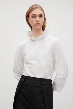 COS image 8 of Frill-neck blouse in White