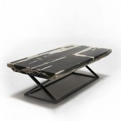 SOLOR Block table, top in black assorted petrified wood on antique black powder coated iron base crossed #Cravt #Original #Craftsmanship #Living #Furniture #Luxury #Interior #Coffee #Tables #Petrified #Wood