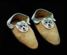 Slippers. Caribou and moose hide, silk embroidery thread, dyed horsehair, silk ribbon, wool and sinew.  In embroidering thistles on slippers for a Scottish aristocrat's daughter, Mary Tate simultaneously appealed to a young girl's desire to dress fashionably and to her client's national pride.  The Scotch thistle had not yet been introduced to western Canada in 1859. But Mary Tate would have been familiar with the plant's bell-shaped flower through representations on imported fabrics, china…