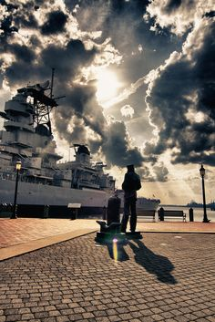 The Lone Sailor statue and USS Wisconsin (BB-64), Norfolk, Virginia.