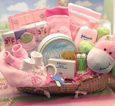 What to put in a baby gift basket - There are many items you can put into a baby basket. Clothes, blankets, bibs/burp cloths, diapers, bath products, items to feed with, music, toys - even snacks for Mom and Dad.