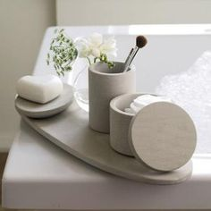 Beautiful bathroom accessories. A classic stone or off white colour will sit back with any bathroom decor.