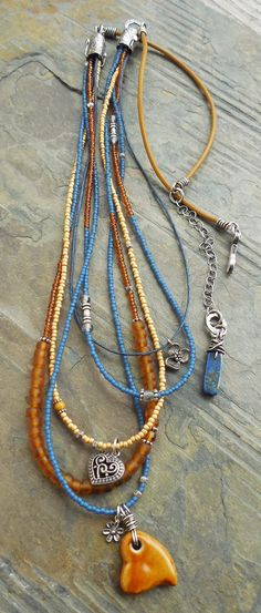 I designed this multi-strand necklace in a slightly longer length, to be worn layered with your favorite shorter pendants or chains. I started with a