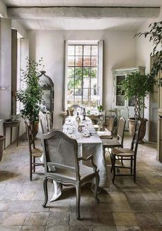 Beautiful greenery in this French country dining room via French Farmhouse