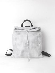 A softly structured backpack in white perforated leather. Feminine, contemporary and minimal, it is ideal for dynamic and modern women and for a casual-chic daywear look. The closure with the foldover top and the smart detail with the leather strings define this backpack adding a different character to the accessory and to your outfit. Combination of perforated calfskin leather and pigskin leather, yet so light. The spacious interior satisfies with its material as it is lined in white… Modern Backpack, White Backpack, Modern Women, Modular Design, Casual Chic, Fashion Bags, Minimal, Feminine, Trending Outfits