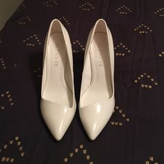 White ALDO heels, size 7 White ALDO heels, size 7. Only worn for engagement pictures. One scuff on the inside left foot. ALDO Shoes Heels