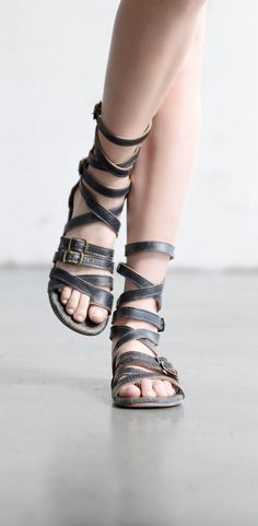 Breathe easy with distressed black leather sandals by BEDSTU. This gladiator style sandal pairs beautifully with anything that shows it off like dresses, skirts, or shorts.
