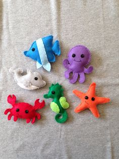 This listing includes a dolphin, octopus, crab, seahorse, fish and starfish. Each ocean friend measures about 4 inches tall. Each ocean creature is made from felt and is completely handstitched by me. All my products are made in a smoke free, pet free home.  Ocean Friends ship in 1-2 weeks.