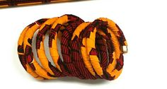 Check out this item in my Etsy shop https://www.etsy.com/listing/257151036/yellow-red-curled-ankara-bracelet