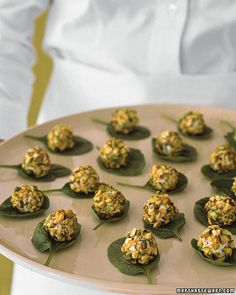 Goat cheese, rolled in pistachios, on a spinach leaf. Yum!