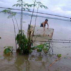 A boy riding a makeshift raft in a ricefield turned into a lake due to monsoon downpour in Tanay, Rizal on August 7, 2012