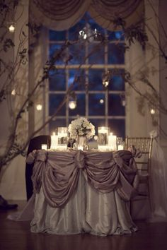sweetheart table - ignore the linens - NO FLOATING - use regular candles