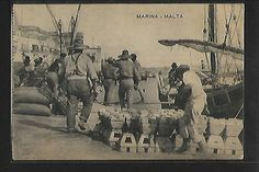 An old postcard of Port workers at the Marina in Grand Harbour, Valletta, Malta unloading merchandise (limestone stoves - Kenur) from a Gozo Boat known as tal-Latini. Old Pictures, Old Photos, Maltese People, Malta Food, Malta History, The Old Days, Old Postcards, The Past, Old Things