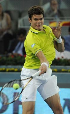 Canadian Milos Raonic returns a ball against Swiss Roger Federer during their tennis match of the Madrid Masters on May 9, 2012 at the Caja Magica sports complex in Madrid.