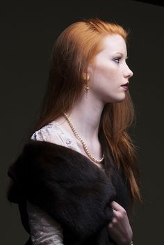 Auburn hair, black and pearls... simple and stunning.