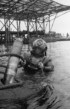 6th October 1945: A diver who has been working on a wrecked German U-Boat before it is raised and destroyed in the harbour at Kiel in Germany. Original Publication: Picture Post - 2094 - Kiel : Graveyard Of The German Navy - pub. 1945 (Photo by Haywood Magee/Picture Post/Getty Images)