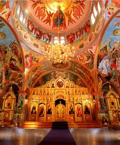 An Eastern Rite church with its ornate iconostasis. An iconostasis is a screen to display icons.