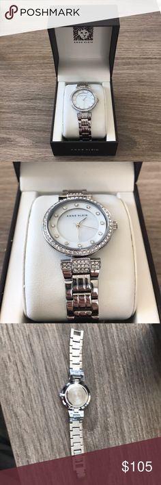 Anne Klein Swarovski Crystal-Accented Watch Polished bracelet watch featuring dazzling Swarovski crystals on bezel, lugs, and mother-of-pearl dial.  32 mm metal case with mineral dial. Alloy band with jewelry-clasp closure. Water resistant to 30 m (99 ft). Stainless steel case back.  I've worn this twice and got it for my birthday in November. Perfect condition! Anne Klein Jewelry Bracelets