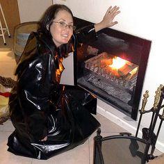 Adele keeping warm in her black rubber mackintosh