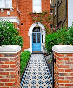 Elms Front Garden - Really Nice Gardens. New walls, piers and cast iron gate create a smart first impression and the vibrant Victorian tiled path lead to a complementary blue door. Front Garden Path, Front Path, Garden Paths, Victorian Front Garden, Victorian Terrace, Victorian Cottage, Terrace House Exterior, Cast Iron Gates, Blue Mosaic Tile