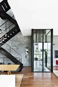 six-story townhouse in  features suspended, open floors connected by a black steel staircase (or a glassed-in elevator). Style At Home, Interior Stairs, Interior Architecture, Living Spaces Furniture, Elevator Design, Estilo Interior, Glass Elevator, Elevator In House, Stair Elevator