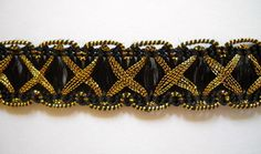 DoveOriginalsTrims - Black and Metallic Gold Crossover Braid Trim Sold By The Yard, $1.29 (http://www.doveoriginalstrims.com/black-and-metallic-gold-crossover-braid-trim-sold-by-the-yard/)