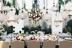 Drape your aerial space with collections of florals and chandeliers to give a varying textures and forms.