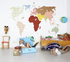 wall of maps. what if you did it in different fabrics?
