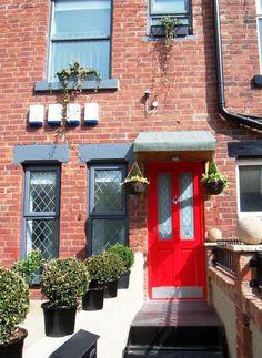 Red door, red brick, grey windows, a little bit of Leeds
