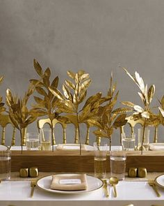 Gold dipped leaves, drilled into a wooden runner