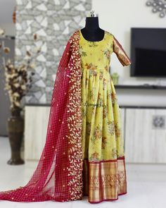 Yellow floral chequered organza dress with big red kanchi style border paired with red organza cutwork dupatta .Many other colors available.Please DM for color choices.Can be done as a lehenga too. Designer Anarkali Dresses, Designer Party Wear Dresses, Kurti Designs Party Wear, Designer Wear, Long Gown Dress, Saree Dress, Long Dresses, Long Frock, Prom Dresses