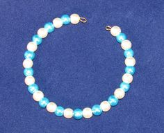 Glass pearl bangle in blue and white.