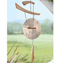 wind gong~This delicate wind chime adds another Japanese element to your garden while de-stressing your life with its soothing sound.