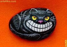Cheshire cat painted rock cat HOPING my twisted Folk Art Tricky Bits Cheshire Cats are cuter and more friendly looking, but I still really like this one .. Xo