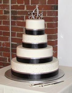 What I like for my wedding cake. Quilted with silver monogram cake toppers. But champagne ribbon instead of black