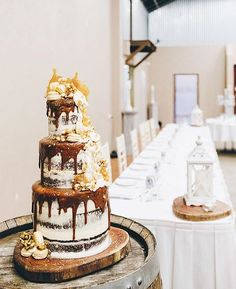 Three tiers of flourless chocolate caramel brownie cake. Dripping with salted…